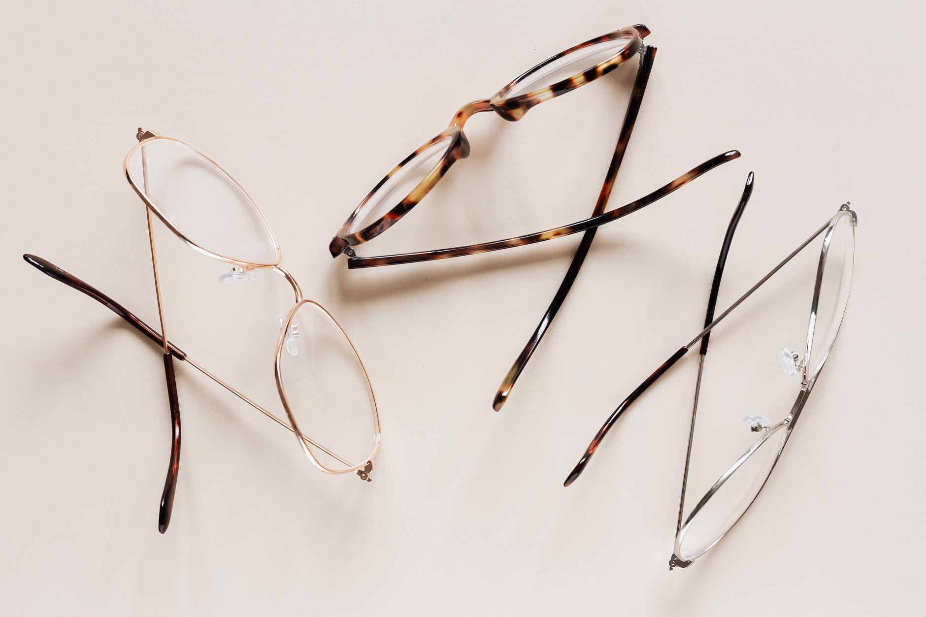 stylish eyeglasses arranged on white desk