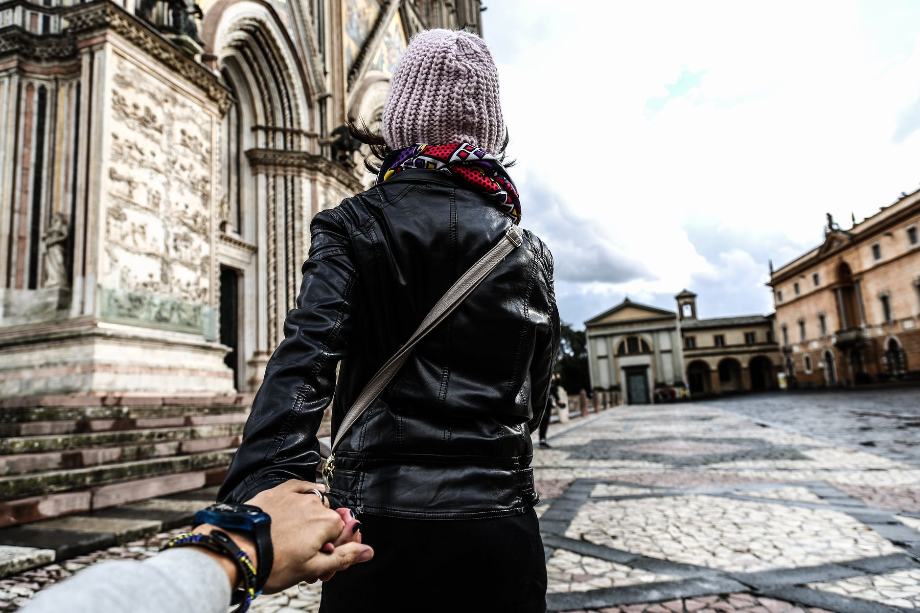 photo of man holding woman s hand